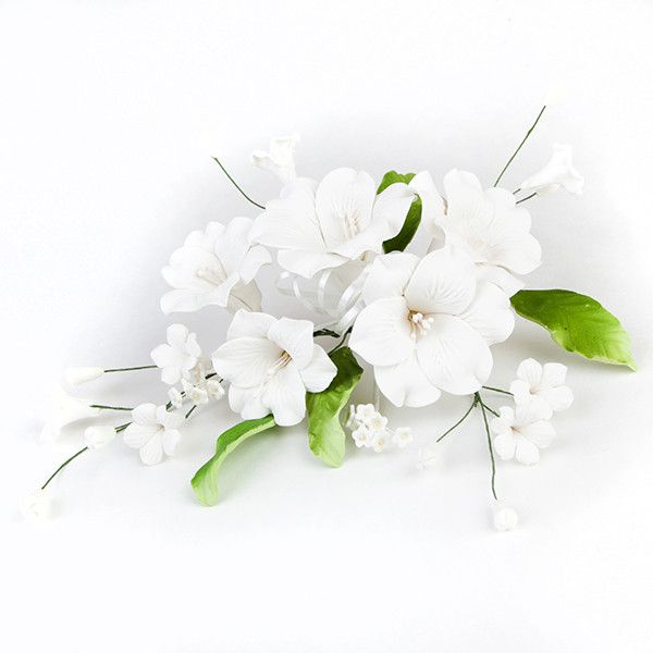 Open Lily Sprays in White are gumpaste sugarflower cake decorations perfect as cake toppers for cake decorating fondant cakes and wedding cakes. Caljava wholesale cake supply.