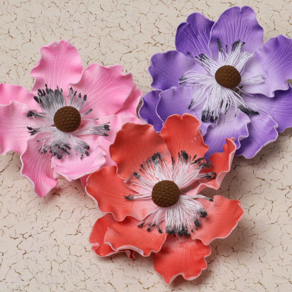 Mixed colors of gumpaste Anemone gumpaste sugarflower cake decoration perfect for decorating wedding cakes.  Wholesale cake supply.  Bakery Supply.