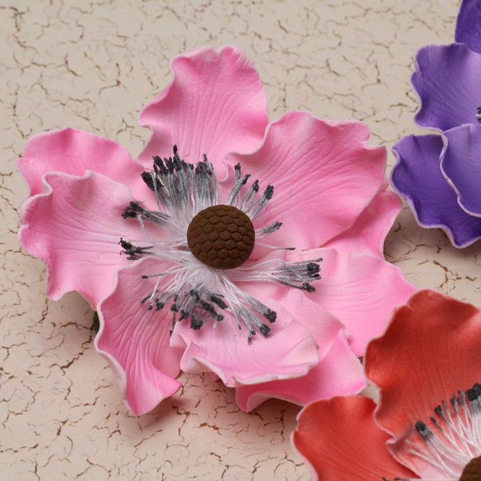 Mixed colors of gumpaste Anemone gumpaste sugarflower cake decoration perfect for decorating wedding cakes.  Wholesale cake supply.  Caljava Bakery Supply.