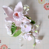 Large Cymbidium Orchid Gumpaste Sugarflower Sprays perfect as a cake topper for cake decorating fondant cakes.  Wholesale Sugarflowers and cake supply. Caljava