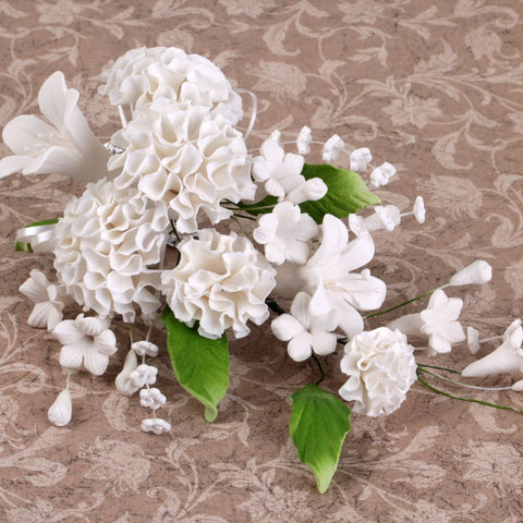 Gumpaste Carnation Sugarflowers are perfect cake decorating fondant wedding cakes & cupcakes. Handmade cake toppers from gumpaste/fondant. Wholesale sugarflower. Caljava Bakery Supplies
