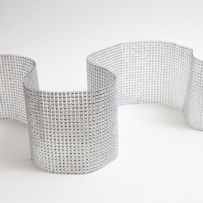Silver Glam Ribbon Diamond Cake Wraps. Perfect for cake decorating rolled fondant cakes & wedding cakes. Cake decoration. Diamond Mesh. Caljava wholesale cake supply. FondX