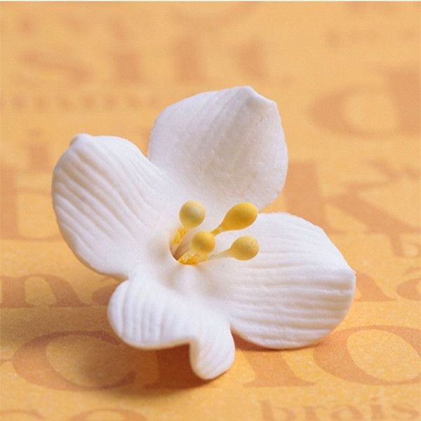 Browallia Flowers gumpaste sugarflower cake topper perfect for cake decorating fondant cakes and cupcakes. Wholesale cake supply. Caljava