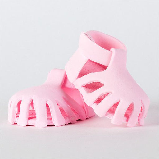 Edible Pink Baby Sandals handmade from fondant. Mini handmade fondant baby shoes perfect for cake decorating baby shower cakes easily. Works with Cake decorating baby shower cupcakes. Baby shoe
