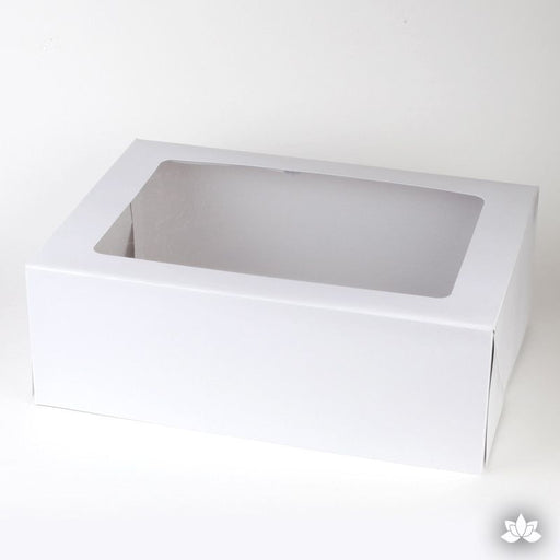 Transport your finished cakes safely with this Window Cake Box. The window allows you to see your beautiful cake creations. White Cake Box