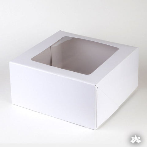 "Transport your finished cakes safely with this Window Cake Box. The window allows you to see your beautiful cake creations.  The convenient side opening of the box makes moving the cake in and out of the box easy. 9"" White Cake Box."