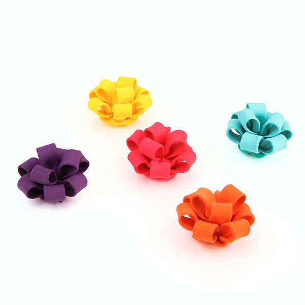 Fondant Cupcake Bows in assorted hot colors. Wholesale Available.