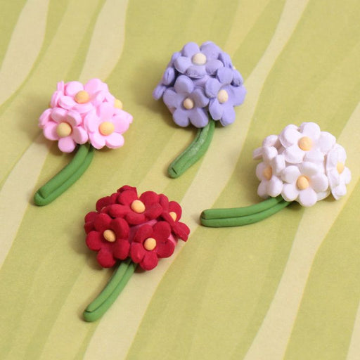 Mini Daisy Sprays from gumpaste sugar flower cake decoration perfect for cake decorating cupcakes or fondant cakes. | CaljavaOnline.com