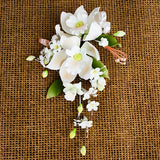 Double Tropical Orchid Sprays in Peach are gumpaste sugarflower cake decorations perfect as cake toppers for cake decorating fondant cakes and wedding cakes. Caljava wholesale cake supply.