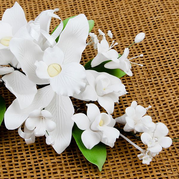 Double Tropical Orchid Sprays in White are gumpaste sugarflower cake decorations perfect as cake toppers for cake decorating fondant cakes and wedding cakes. Caljava wholesale cake supply.
