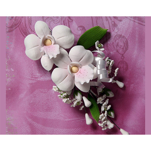 African Orchid Sugar flower cake toppers great for cake decorating your own cake. Edible cake topper made from gum paste used for making your cake designs.
