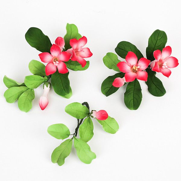 Cambodia Sprays in Pink are gumpaste sugarflower cake decorations perfect as cake toppers for cake decorating fondant cakes and wedding cakes. Caljava wholesale cake supply.