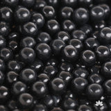 Chocolate Candy Pearls used for cake decorating or cupcake decorating.  Edible cake decorations.  Wholesale cake supply. Caljava