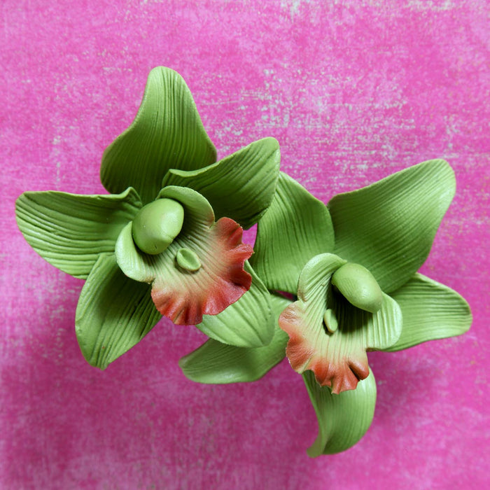 Orchid Sugar Flower Cake Toppers great for cake decorating your own birthday cakes. Made from gum paste, ready to be placed on the cake.