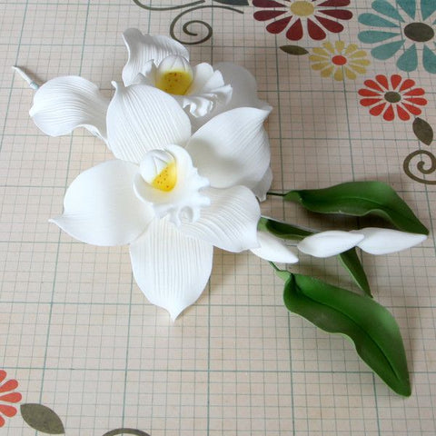 White Cymbidium Gumpaste Orchid Spray cake topper & cake decoration perfect for cake decorating rolled fondant wedding cakes and rolled fondant birthday cakes.  Wholesale sugarflowers and cake supply. CaljavaOnline.com