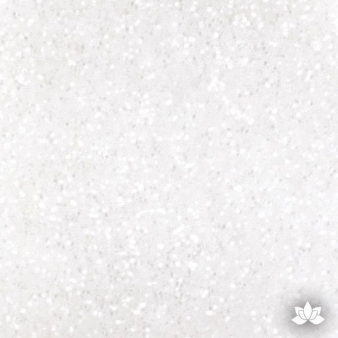 Snow White Disco Dust Pixie Dust. Disco Dust is a Non-toxic fine glitter for cake decorating that will add a touch of color to your fondant cakes & cupcakes.  Caljava Wholesale cake supply. FondX