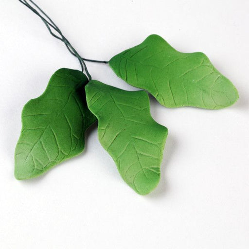 Green Holly Leaf Sugarflower made from gumpaste perfect for cake decorating Christmas cakes & cupcakes & other holiday cakes.  Wholesale cake decorations.
