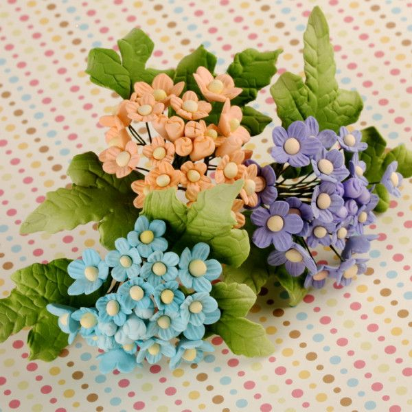 Gumpaste Forget Me Not Flower Fillers mixed colors for cake decorations for fondant wedding cakes & cupcakes.