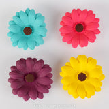 Colored Gumpaste Daisy cake decorations perfect for cake decorating rolled fondant wedding cakes and rolled fondant birthday cakes and cupcakes.  Wholesale sugarflowers & cake decorating products.