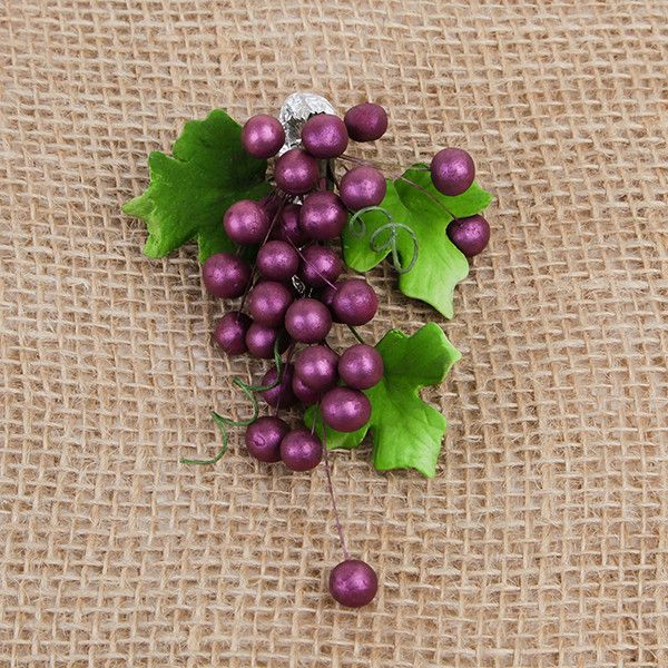 These beautiful Grape sprays in Burgundy are readymade by hand from gumpaste.  Gumpaste flowers offer a way of decorating cakes hassle free for both professional and amateur decorators.  Each spray is bound by bendable wires that make for easy positioning and application on cakes.