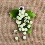 These beautiful Grape sprays in Green are readymade by hand from gumpaste.  Gumpaste flowers offer a way of decorating cakes hassle free for both professional and amateur decorators.  Each spray is bound by bendable wires that make for easy positioning and application on cakes.