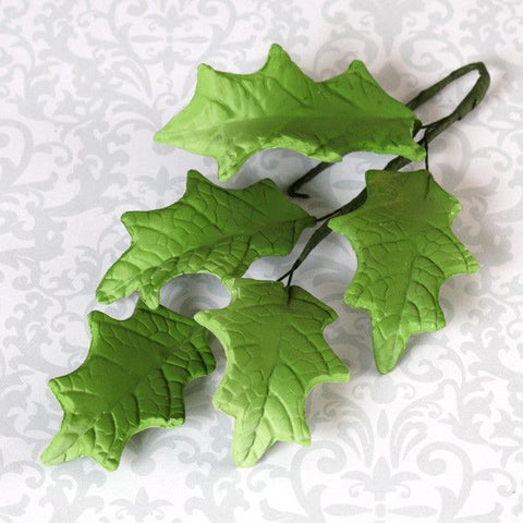 Holly leaf sugarflower from gumpaste perfect for cake decorating fondant cakes and wedding cakes. Wholesale sugarflowers and cake supply.