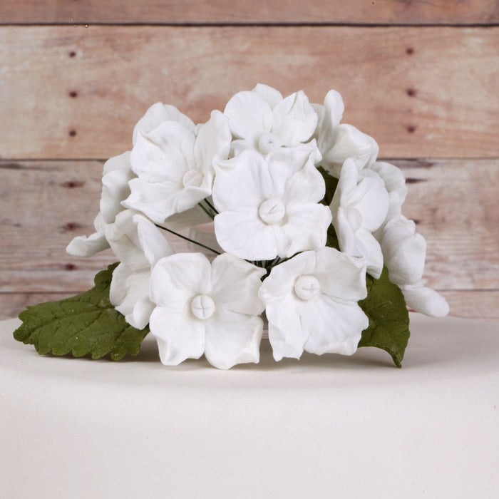 White Hydrangeas and Leaves sugarflowers from gumpaste cake decorations perfect for cake decorating fondant cakes as a cake topper.  Wholesale bakery supplies.