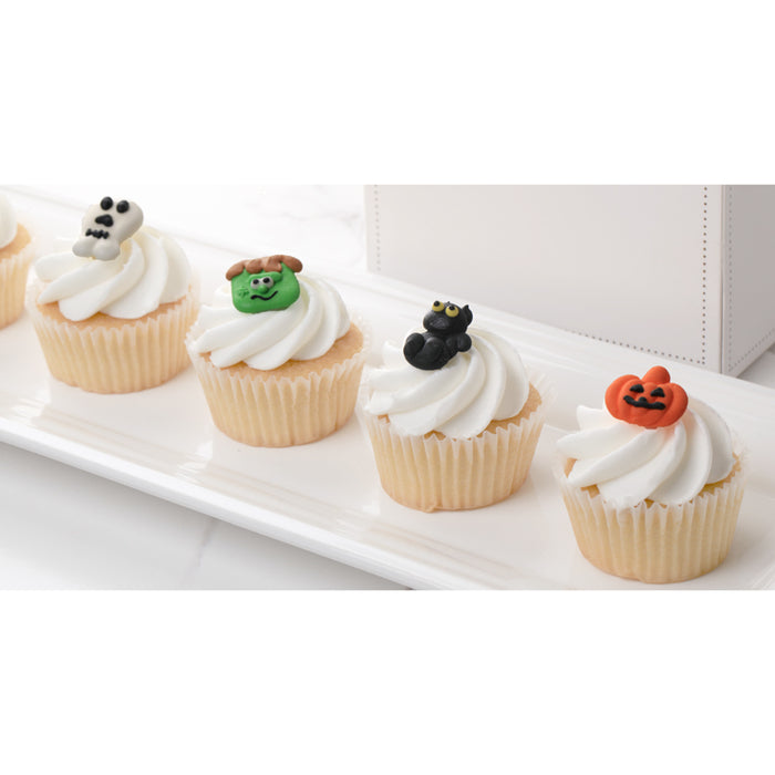 Halloween Royal Icing Toppers for decorating your own cupcakes, chocolates, cookies, cakes, and other desserts. Edible hand piped icing toppers ready to use on your food.