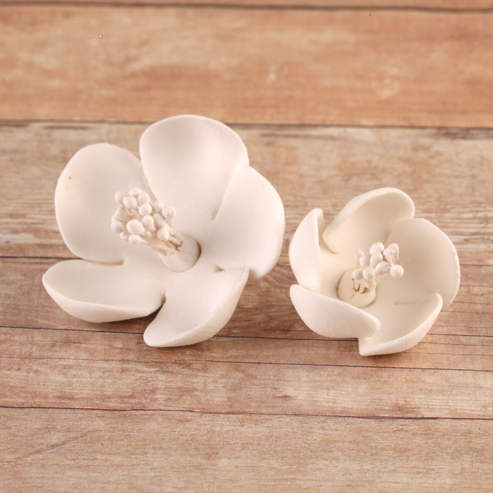 Edible Gumpaste White Cherry Blossoms No Wire sugar flower cake toppers and cake decorations perfect for cake decorating rolled fondant wedding cakes, cupcakes and birthday cakes and cupcakes.  Edible Cake Decoration and wholesale cake supplies.