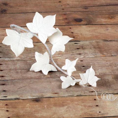 White Ivy Leaf Filler Spray handmade gumpaste cake decoration perfect for rolled fondant wedding cakes and birthday cakes.  Wholesale cake decorations.  Wholesale cake supply.