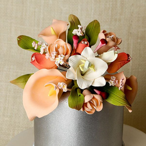Achieve a sense of refinement and innocence, and easily place these gorgeous Peach Casablanca Lilies on top of your cakes.  Readymade by hand from gumpaste.  Gumpaste Flowers offer a way of decorating cakes hassle free for both professional and amateur decorators.