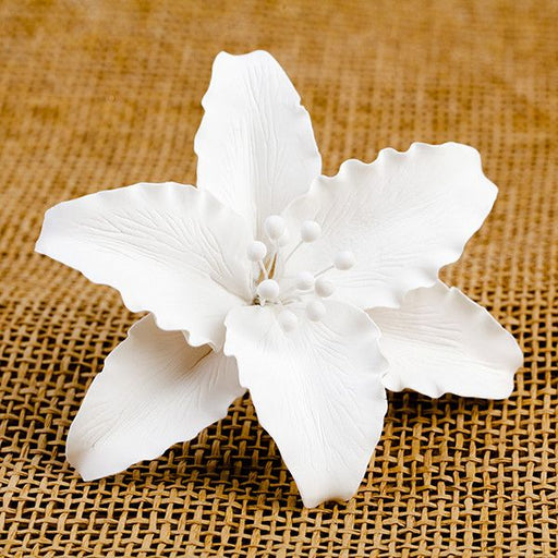 Casablanca Lilies are gumpaste sugarflower cake decorations perfect as cake toppers for cake decorating fondant cakes and wedding cakes. Caljava wholesale cake supply.