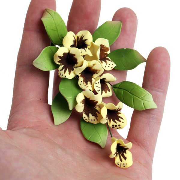 Yellow Tropical Fillers gumpaste sugarflower cake decorations perfect as cake toppers for cake decorating fondant cakes and wedding cakes.  Wholesale sugarflowers. Caljava