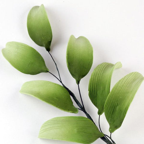 7 Petal Lily Green Leaf Filler sugarflower from gumpaste perfect for cake decorating fondant cakes and wedding cakes. Wholesale sugarflowers and cake supply.