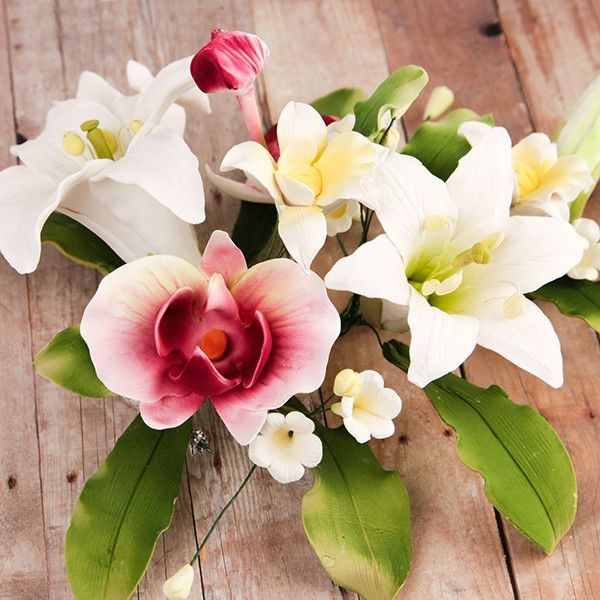 Day Lily & Phalaenopsis Large Orchid Sprays are gumpaste sugarflower cake decorations perfect as cake toppers for cake decorating fondant cakes and wedding cakes. Caljava wholesale cake supply.