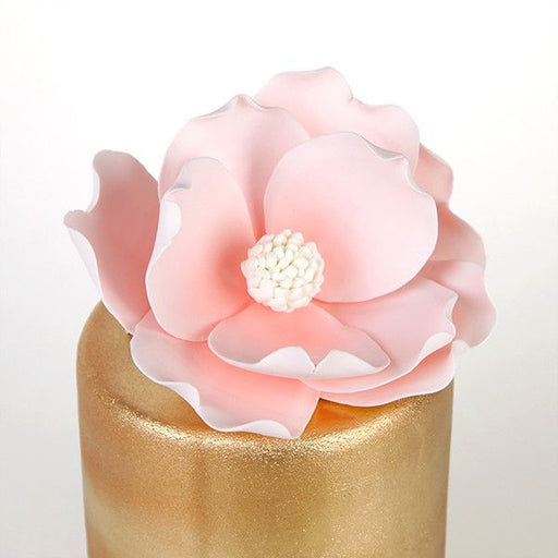 Pink Gumpaste Magnolia Cake Topper and Cake Decoration perfect for Cake Decorating rolled fondant wedding cakes and rolled fondant birthday cakes.  Wholesale bakery supplies. Cake topper