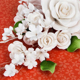 Large Open Rose Sprays in White are gumpaste sugarflower cake decorations perfect as cake toppers for cake decorating fondant cakes and wedding cakes. Caljava wholesale cake supply.