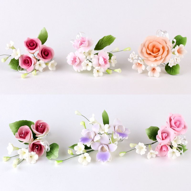 Variety of readymade gumpaste sugarflower sprays cake toppers perfect for cake decorating rolled fondant wedding cakes and fondant custom cakes.  Wholesale sugar flowers and cake decoration supply.  Cheap bargain product.