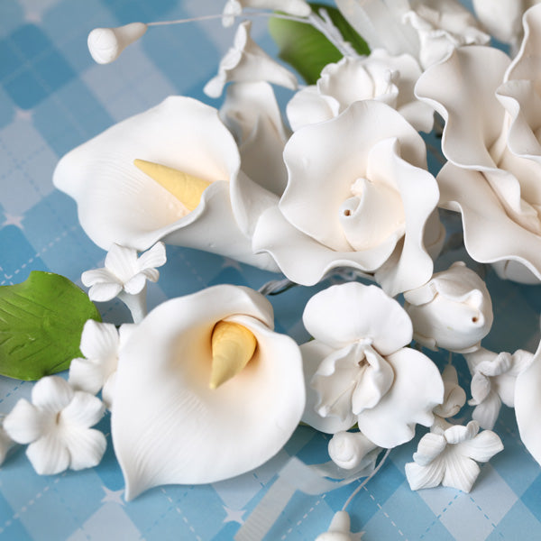 Gumpaste Rose & Calla Lily spray cake topper perfect for cake decorating fondant cakes & wedding cakes.  Wholesale cake decorating supply.  Edible cake decor