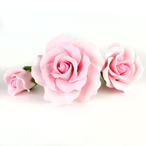 Mixed sizes of pink Gumpaste Roses handmade sugar cake decorations and cake topper perfect for rolled fondant wedding cakes and birthday cakes cake decorating. Wholesale sugarflowers and cake supply. Caljava