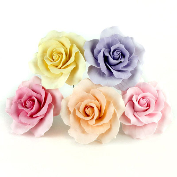 Mixed colors and sizes of Gumpaste Roses handmade sugar cake decorations and cake topper perfect for rolled fondant wedding cakes and birthday cakes cake decorating. Wholesale sugarflowers and cake supply. Caljava
