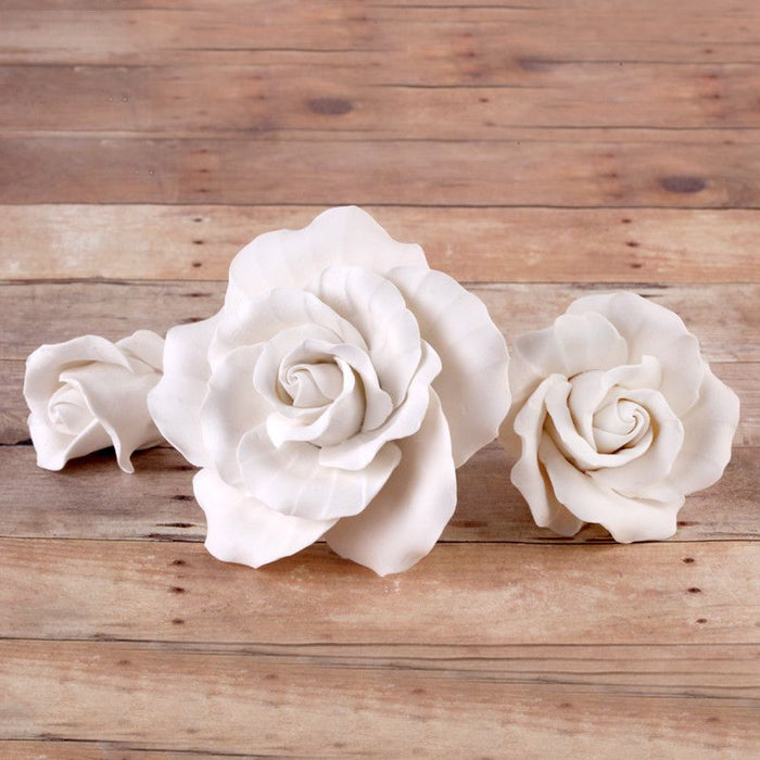 White English Gumpaste Roses handmade sugar cake decorations and cake toppers perfect for cake decorating rolled fondant wedding cakes and fondant birthday cakes.  Wholesale sugar flowers and cake supply. Caljava