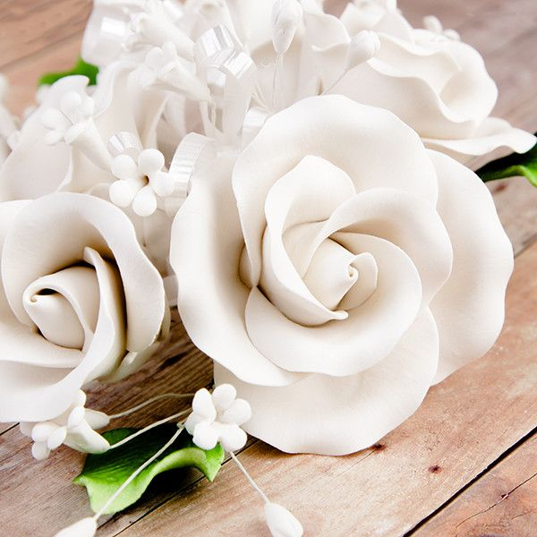 Garden Rose Sprays in White are gumpaste sugarflower cake decorations perfect as cake toppers for cake decorating fondant cakes and wedding cakes. Caljava wholesale cake supply.