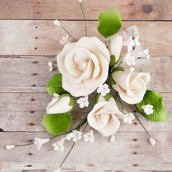 Trio Garden Rose Sprays in Ivory are gumpaste sugarflower cake decorations perfect as cake toppers for cake decorating fondant cakes and wedding cakes. Caljava wholesale cake supply.