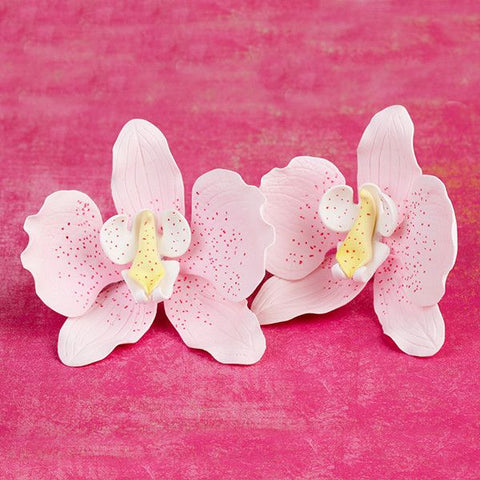 Phalaenopsis Orchids in Light Pink are gumpaste sugarflower cake decorations perfect as cake toppers for cake decorating fondant cakes and wedding cakes. Caljava wholesale cake supply.