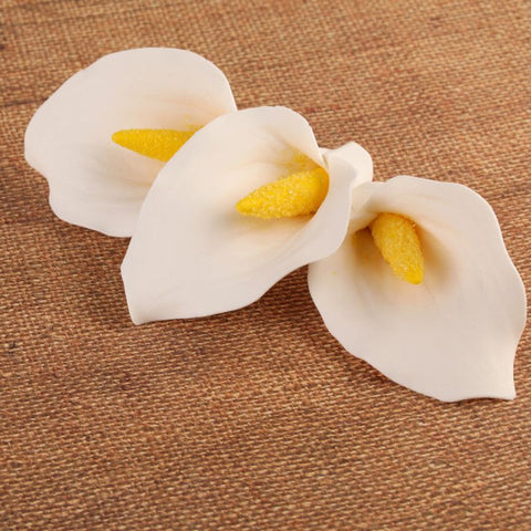 Medium gumpaste calla lily cake decoration perfect as a cake topper for cake decorating rolled fondant wedding cakes and rolled fondant birthday cakes, also works as a great cupcake decoration.