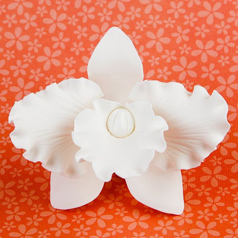 Large Cattleya Orchids in White are gumpaste sugarflower cake decorations perfect as cake toppers for cake decorating fondant cakes and wedding cakes. Caljava wholesale cake supply.