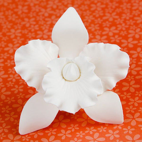 Medium Cattleya Orchids in White are gumpaste sugarflower cake decorations perfect as cake toppers for cake decorating fondant cakes and wedding cakes. Caljava wholesale cake supply.