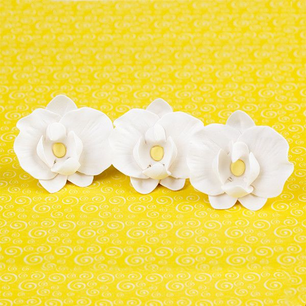 Hawaiian Phalaenopsis Orchids in Light Pink are gumpaste sugarflower cake decorations perfect as cake toppers for cake decorating fondant cakes and wedding cakes. Caljava wholesale cake supply.