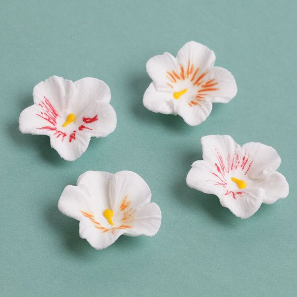 White Petite Pansies Gumpaste Sugarflower edible cake decoration perfect for adding on top of your cakes and cupcakes.